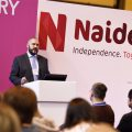 Naidex logo and speaker
